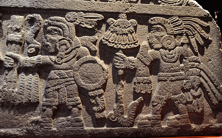 Aztec stone carving used as inspiration for Jose Luis's custom wedding ring by Takayas
