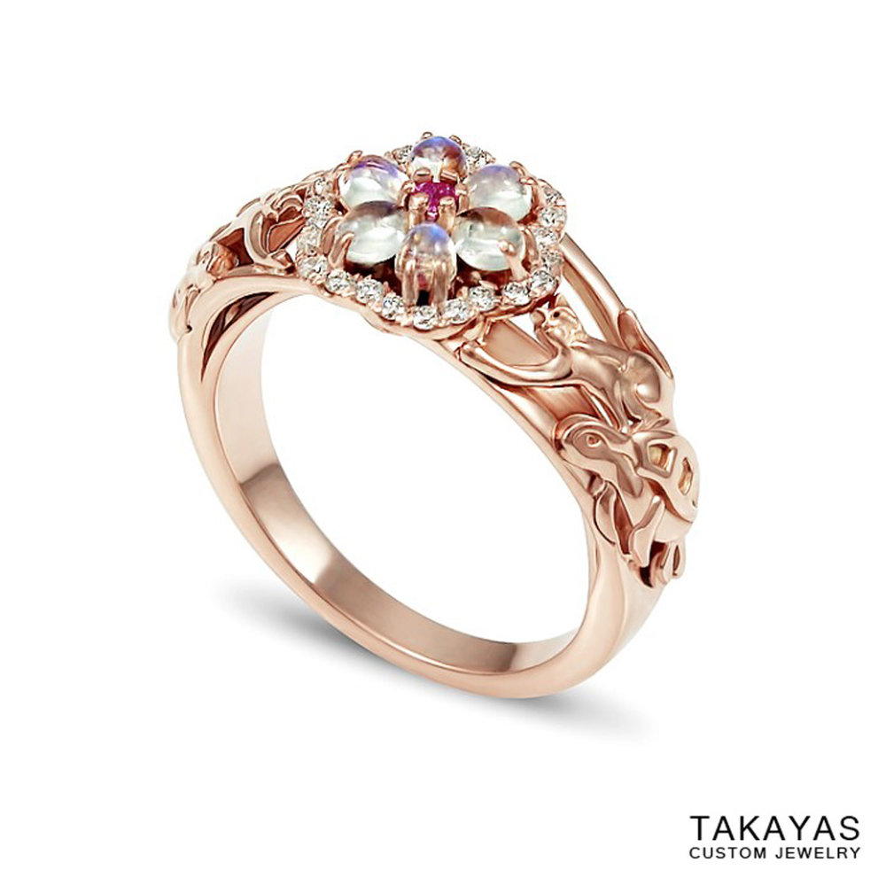 Custom rose gold cat and turtle engagement ring with a flower centerpiece of moonstones, diamonds, and a pink sapphire, by Takayas Custom Jewelry