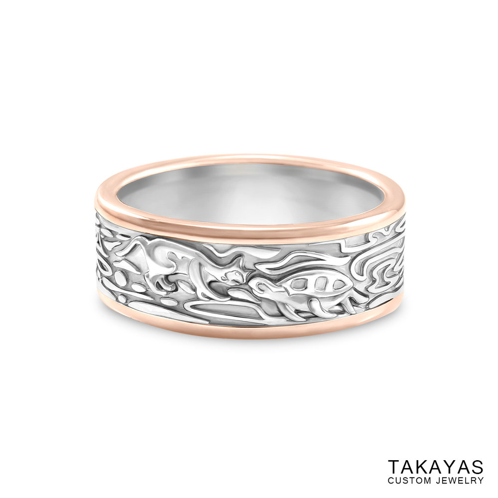 Photograph of custom men's wedding band with a cat and turtle kissing and organic patterns, by Takayas Custom Jewelry - front view