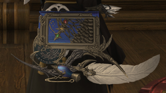 Infi's FFXIV Scholar character's book weapon, used as inspiration for her custom engagement ring by Takayas