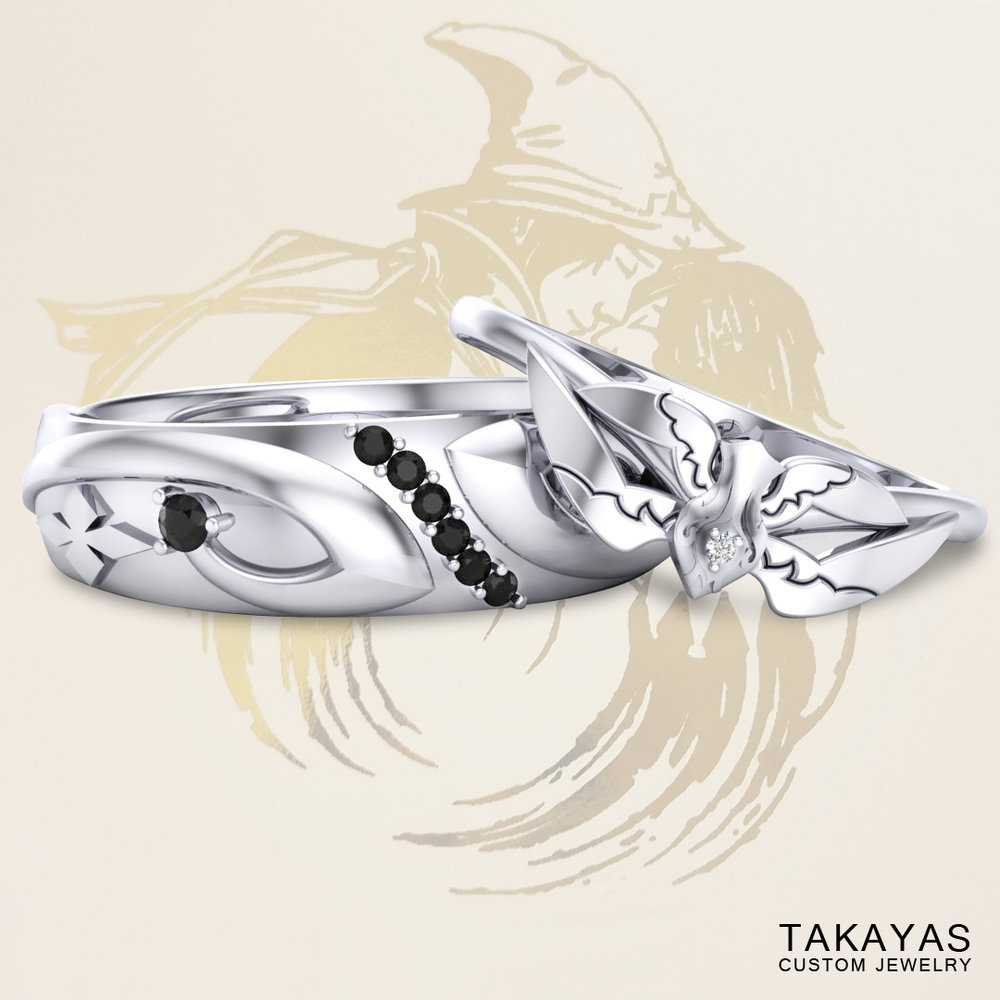 Final Fantasy Black & White Mage inspired wedding rings by Takayas, with Ben and Cassie's custom wedding invitation logo in the background
