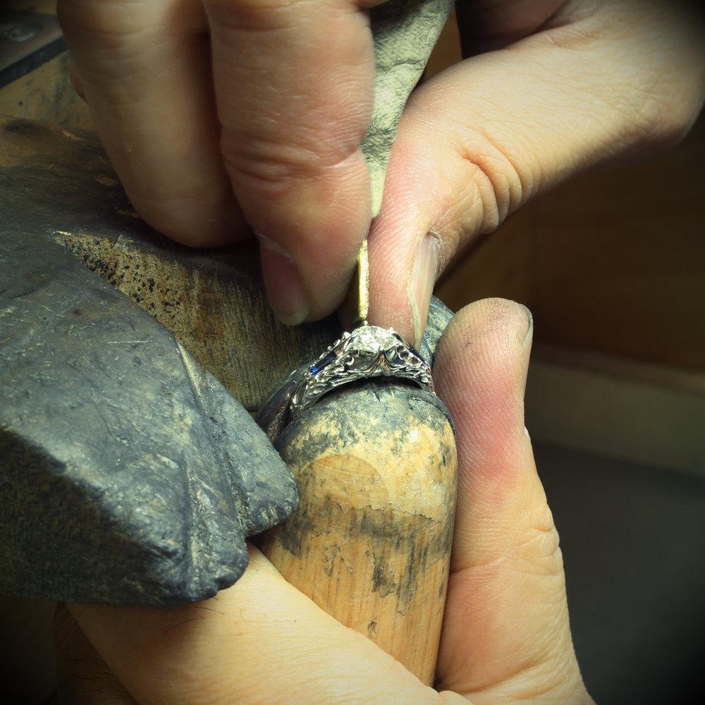 Takayas setting the center stone in the custom FFXIV Scholar inspired ring