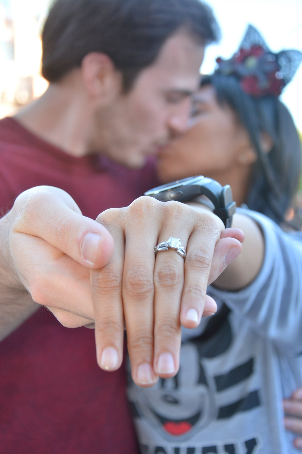 David and Sharon, newly engaged at Disneyland with their custom Kingdom Hearts Oathkeeper and Wayfinder solitaire engagement ring by Takayas Custom Jewelry